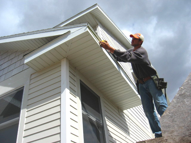 Installing gutters on home